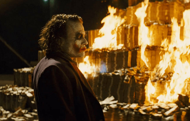 Joker-burns-cash-Warner-Bros.png