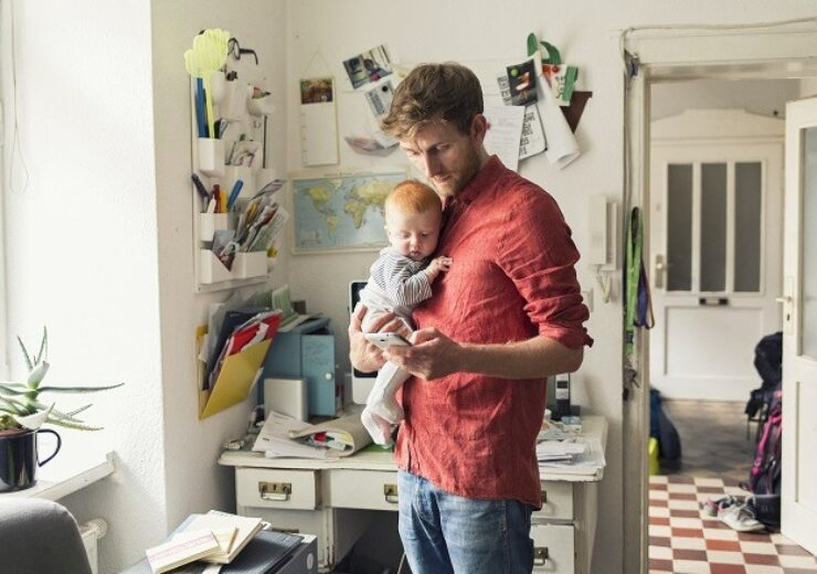 Father with baby son (12-23 months) using smart phone